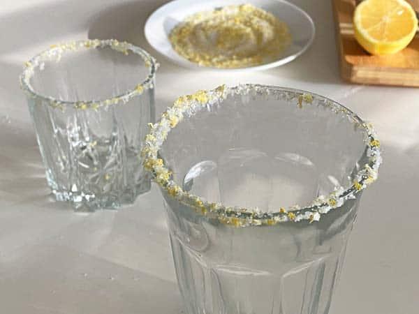 two glasses with lemon rim salt
