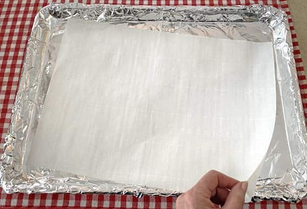 line pan with foil and parchment paper