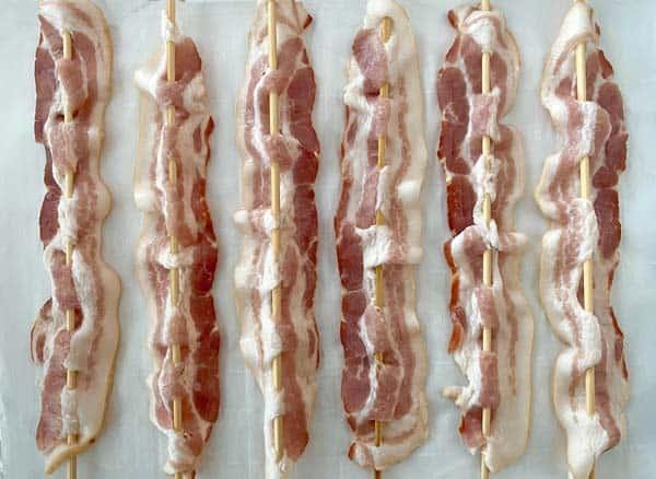 bacon skewers on a baking sheet