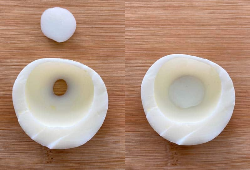 An egg white shell with a hole in the end, and small round trimming from the end of an egg white used to fill the hole