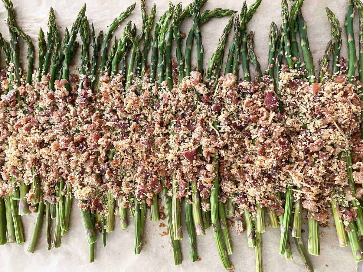 Oven roasted asparagus spears with a topping of crumbled bacon bits, bread crumbs and parmesan cheese.