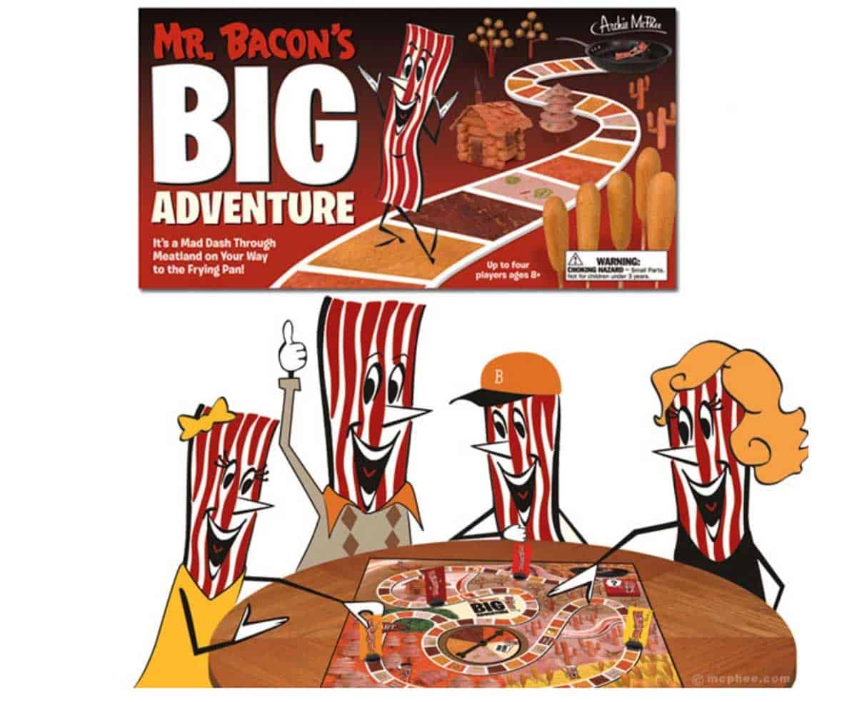 The board game Mr. Bacon's Big Adventure set up on.a card table, with the box shown at the top of the image.