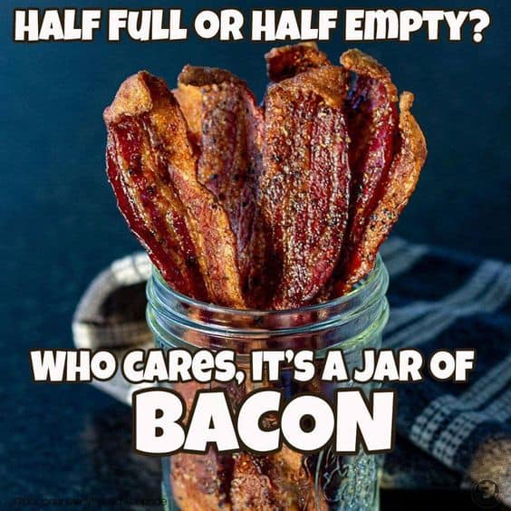A jar of candied bacon and text:  Half full or half empty? How cares, it's a jar of BACON.