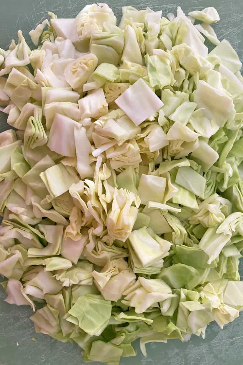 chopped cabbage on a green cutting board