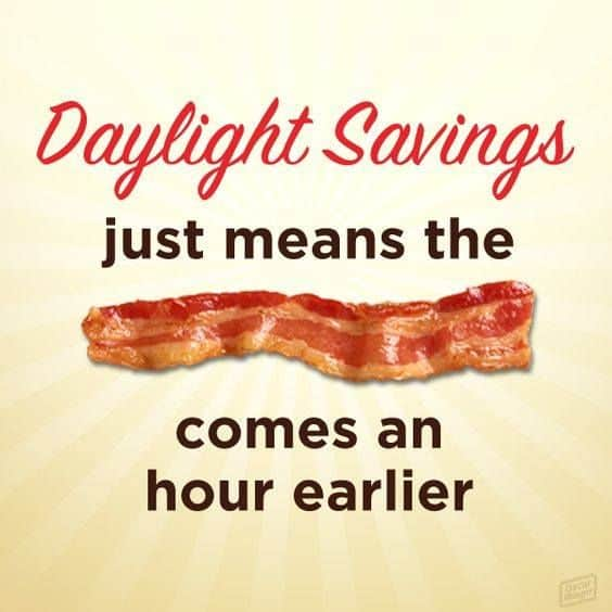 A strip of bacon and text: Daylight Savings just means the bacon comes an hour earlier