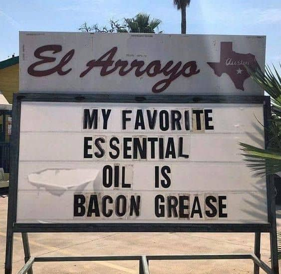A sign which reads: My favorite essential oil is bacon grease