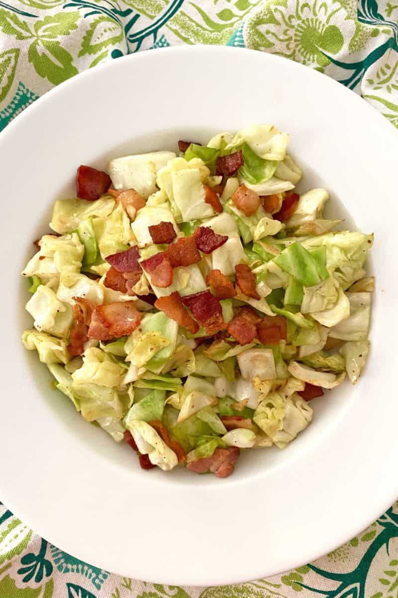 serving dish with finished fried cabbage and bacon