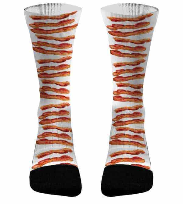 White gym socks adorned with black toes and a bacon strip all-over print.