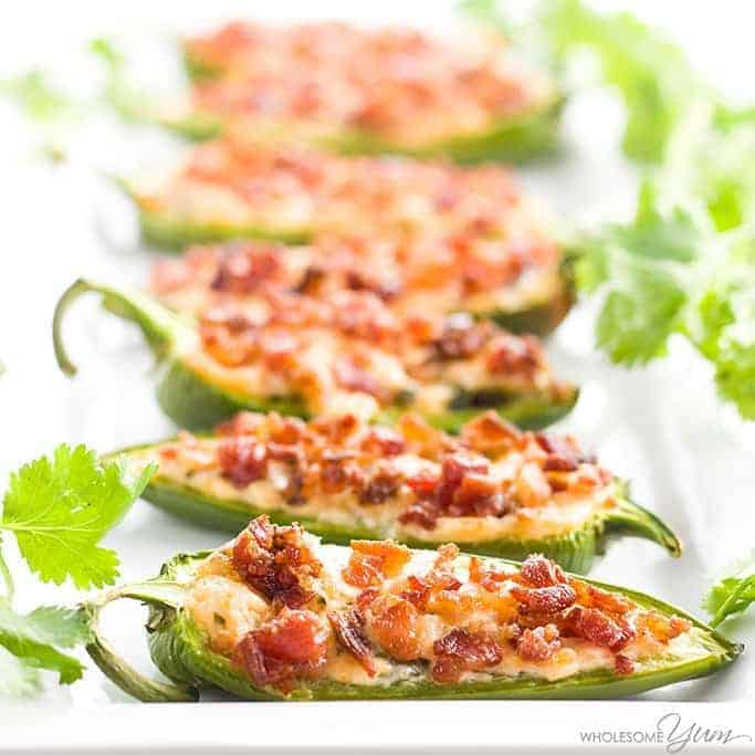 5 pieces of bacon jalapeno poppers with Italian parsley for garnish
