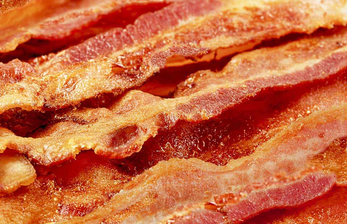 A close up of 8 strips of oven-cooked bacon
